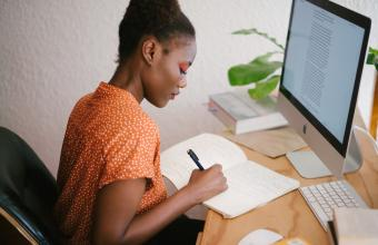 Young woman sits in front of computer, accessing the Internet for research. PIC: Retha Ferguson   Pexels.com
